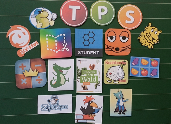 An einer Tafel sind verschiedene Apps und Lernprogrammen zu sehen, die in der Tabletklasse genutzt werden.